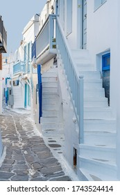 The narrow streets of the island with blue balconies, stairs