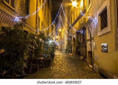 Narrow streets of old Rome at night, Italy