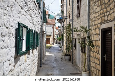 Narrow streets of old town of Trogir in Dalmatia, Croatia, located at the coast of Adriatic sea near city of Split, with traditional Croatian architecture.