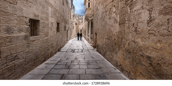 Narrow streets and old walls of the fortress city - Mdina. The former capital of the island state of Malta.