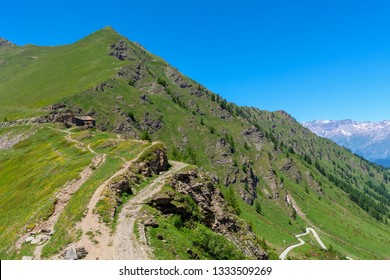 Narrow trail in the mountains at Colle delle Finestre in Piedmont, Northern Italy.