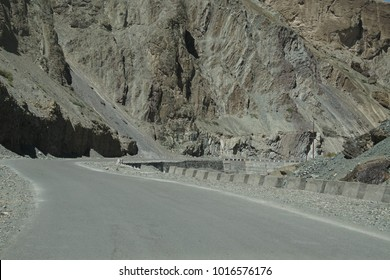 Narrow twisting road along the valley of the Indus river, Ladakh, India