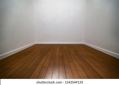 Narrow white room. Three walls of a white room with wood flooring and white trims.