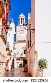 Narrow white streets and a town hall of Locorotondo in Puglia (Apulia) region, southern Italy