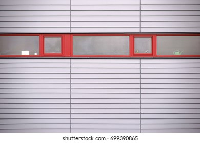The narrow windows of a modern building with a modern wall covering Narrow windows