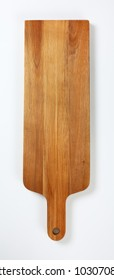 narrow wooden cutting board with handle on white background