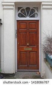 Narrow Wooden Door House Entrance With Transom