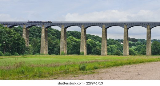 A narrowboat crosses the Pontcysyllte Aqueduct, which carries the canal high above the River Dee, near Llangollen, North Wales.