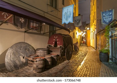 The narrowest street of Riga city, Latvia. Walking through medieval streets of old Riga tourists can feel unforgettable atmosphere of the Middle Ages.