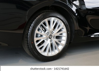 Narva, Estonia 11-6-2019, Car showroom. Aluminum wheel with  Dunlop Tire, Toyota Camry 2019