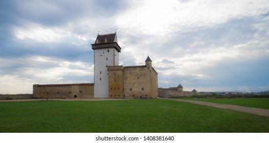 Narva / Estonia - April 24 2019: Medieval Hermann Castle in Narva on the banks of border river that separates  Republic of Estonia (European Union) and Russian Federation.