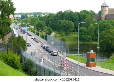 NARVA, ESTONIA - AUGUST 12, 2017: Cars in line on the Friendship Bridge. Crossing the Estonian-Russian border