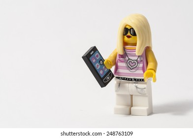NARVA, ESTONIA - JANUARY 31: A Lego toy of a blond girl dressed in pink with sunglasses and a telephone in Narva, Estonia on January 31, 2015