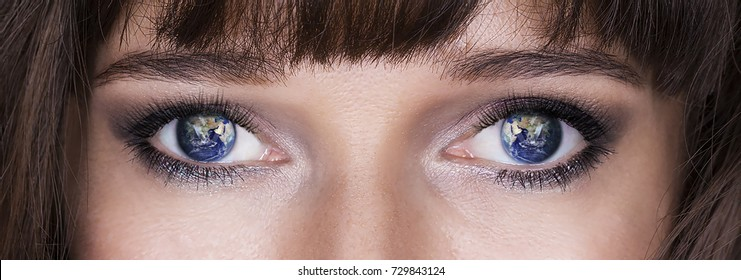 NASA. Reflection of the planet Earth in female eyes.
