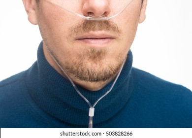 Nasal cannula for oxygen delivery on a bearded man