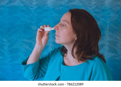 Nasal Spray. Closeup Of Beautiful Young Woman's Face With Nasal Drops