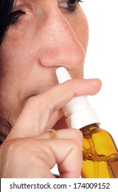 Nasal spray in front of a white studio background
