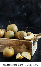 Nashi Pears (apple pears or asian pears) in a box on a dark background