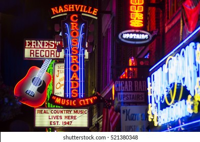 NASHVILLE - JULY 10, 2014: Bright neon signs of the city's honky tonk bar scene line the country music entertainment district of Lower Broadway.