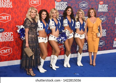 NASHVILLE - JUN 5: Judy Trammell (L) and Kelli Finglass (R) and Dallas Cowboys cheerleaders attend the 2019 CMT Music Awards at Bridgestone Arena on June 5, 2019 in Nashville, Tennessee.