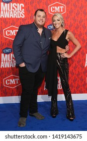 NASHVILLE - JUN 5: Luke Combs (L) and Nicole Hocking attend the 2019 CMT Music Awards at the Bridgestone Arena on June 5, 2019 in Nashville, Tennessee.