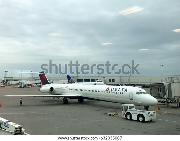Nashville Tennessee - Circa 2017: Delta airlines McDonnell Douglas MD-90 airplane at terminal gate waiting for passengers to board and deport for flight to New York City