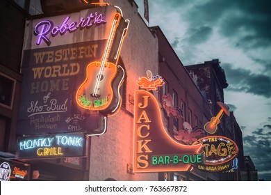 NASHVILLE, TENNESSEE - NOV 22, 2016: Roberts Western World and Jack's Bar-B-Que neon sign along Broadway in Nashville, Tennessee.