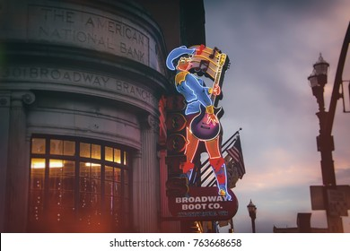 NASHVILLE, TENNESSEE - NOV 22, 2016: Broadway Boot Company cowgirl neon sign along Broadway in Nashville, Tennessee.