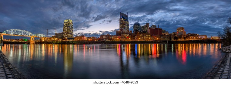 Nashville Tennessee skyline at twilight reflecting in the Cumberland River