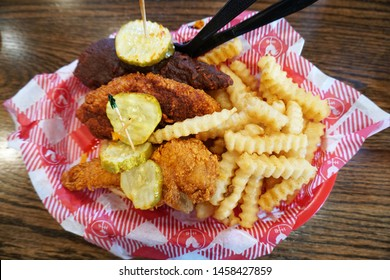 Nashville, Tennessee / USA - 07/20/2019: Extremely Hot Chicken Tenders and Fries meal at the Famous Hattie B's Hot Chicken Restaurant.