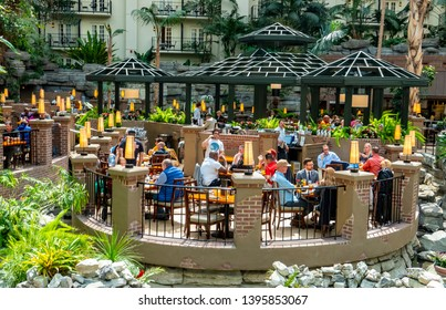 Nashville, Tennessee / USA - April 3 2019:  A group of people eating in a hotel convention center atrium.