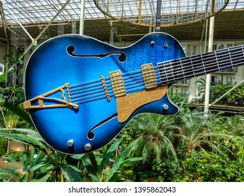 Nashville, Tennessee / USA - April 3 2019: A giant blue guitar hanging as a symbol in a hotel convention center atrium.