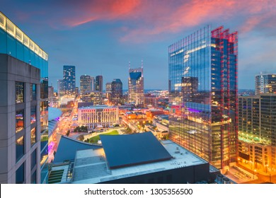 Nashville, Tennessee, USA downtown cityscape rooftop view at dusk.