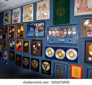 NASHVILLE, TENNESSEE, USA - MARCH 20, 2018: Willie Nelson`s gold and platinum records displayed at Willie Nelson and Friends museum and general store. Main attraction for visitors from all over the wo