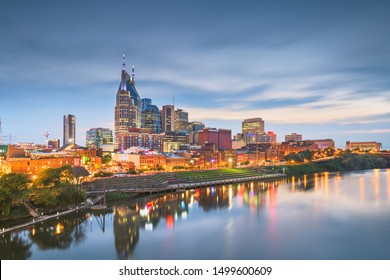 Nashville, Tennessee, USA skyline on the Cumberland River at night.