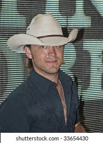 NASHVILLE, TN - JUNE 13: Country singer Justin Moore signs autographs in the Nashville Convention Center during the CMA Festival June 13, 2009 in Nashville, Tennessee.