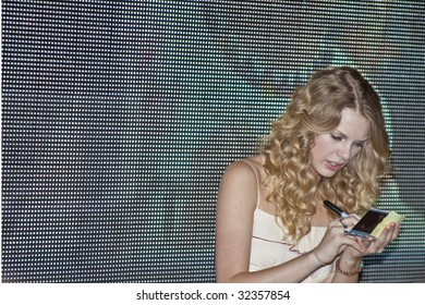 NASHVILLE, TN - JUNE 14: Country singer Taylor Swift signs autographs in the Nashville Convention Center during the CMA Festival June 14, 2009 in Nashville, Tennessee.