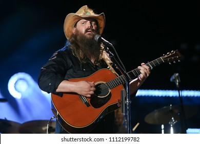 NASHVILLE, TN - June 9: Singer Chris Stapleton performs at the 2018 CMA Fest at Nissan Stadium on June 9, 2018 in Nashville, Tennessee.