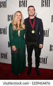 NASHVILLE, TN - NOV 13: Brian Lancaster (R) and wife Tiffany Trotter attend the BMI Country Awards 2018 at BMI Nashville on November 13, 2018 in Nashville, Tennessee.