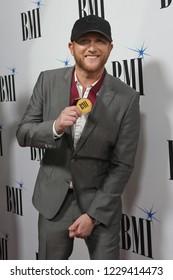 NASHVILLE, TN - NOV 13: Cole Swindell attends the BMI Country Awards 2018 at BMI Nashville on November 13, 2018 in Nashville, Tennessee.