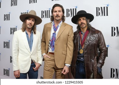 NASHVILLE, TN - NOV 13: (L-R) Jess Carson, Mark Wystrach and Cameron Duddy of Midland attend the BMI Country Awards 2018 at BMI Nashville on November 13, 2018 in Nashville, Tennessee.