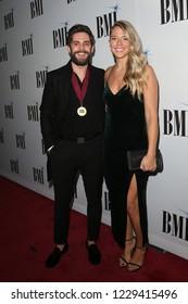 NASHVILLE, TN - NOV 13: Thomas Rhett (L) and wife Lauren Akins attends the BMI Country Awards 2018 at BMI Nashville on November 13, 2018 in Nashville, Tennessee.