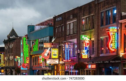 NASHVILLE, TN - OCT 8: Neon signs light the strip along Broadway on October 8, 2017 in Nashville, Tennessee, USA