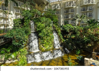 NASHVILLE, TN, USA - February 25, 2018: A look over the waterfall inside the Cascades atrium, one of the three atrium's located inside the Gaylord Opryland Resort & Convention Center.