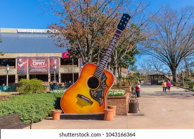 NASHVILLE, TN, USA - February 27, 2018: The Grand Ole Opry is one of the most famous music venues since being created in 1925. The area around it is filled with guitars, a food truck and seating.