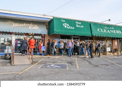 NASHVILLE, TN, USA - MARCH 24, 2019: People queue outside world famous Bluebird Cafe. This music club opened in 1982 and features acoustic music by its composers.