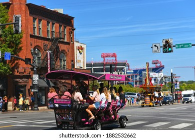Nashville, TN, USA - September 21, 2019:  Revelers enjoy drinks on the Music City Crawler pedal bike tavern on Broadway Street and 2nd Avenue.  These vehicles are powered by pedaling of the passengers
