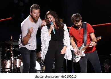 NASHVILLE, TN-JUN 10: (L-R) Charles Kelley, Hillary Scott and Dave Haywood of Lady Antebellum perform in concert at the CMA Music Festival on June 10, 2017 at Nissan Stadium in Nashville, Tennessee.