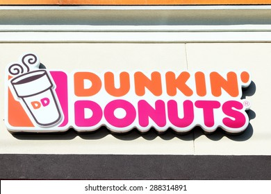 NASHVILLE, TN-JUNE, 2015:  Dunkin Donuts sign.  Dunkin Donuts is an American chain with outlets all over the world featuring donuts and great coffee.