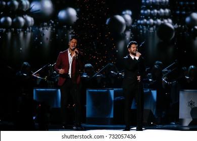 NASHVILLE, TN-NOV 7: Recording artists Dan Smyers (L) and Shay Mooney of Dan + Shay perform at the 2014 CMA Country Christmas at the Bridgestone Arena on November 7, 2014 in Nashville, Tennessee.